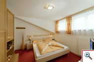 One of the three cosy bedrooms in Apartment 12 at Holiday House Birgit in Pettneu